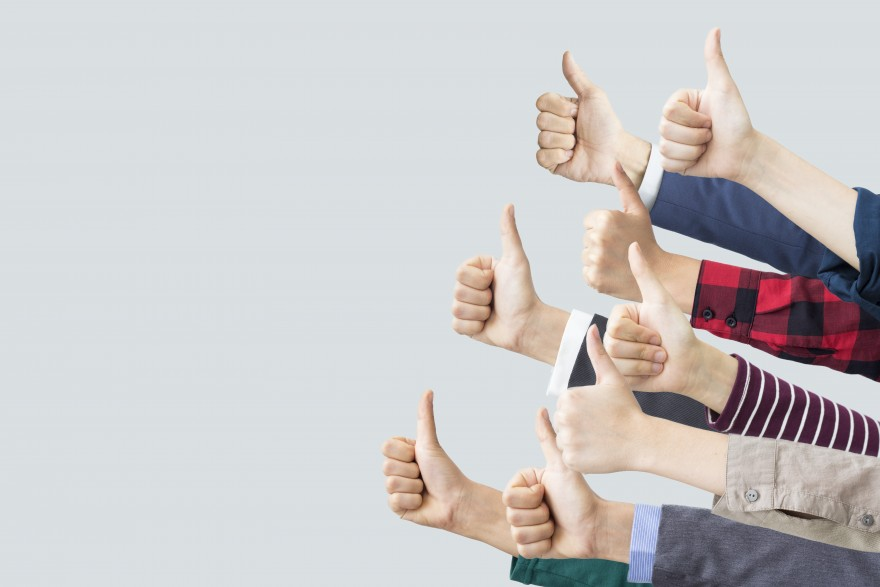 Approval junkies, by Lisa Larter, group of thumbs up