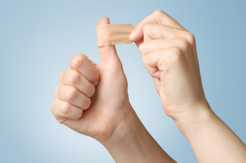 Woman with a bandaid on her thumb
