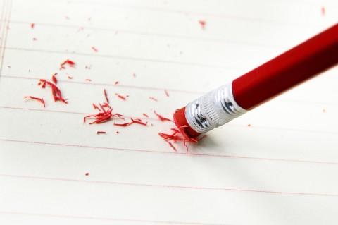 closeup of a pencil eraser correcting a mistake