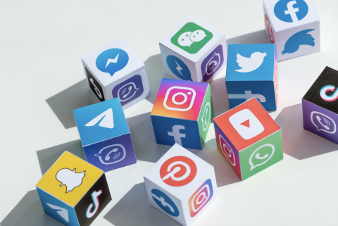 Building blocks with social media icons on them.