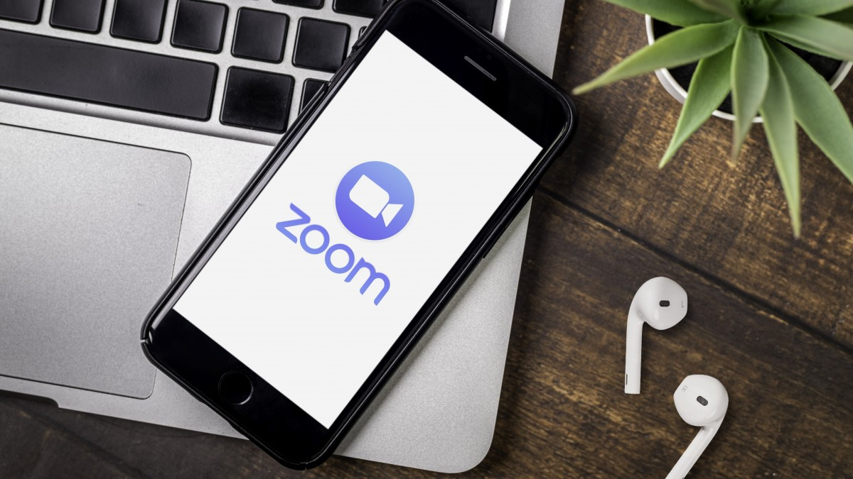 Smart phone showing Zoom Cloud Meetings app logo.