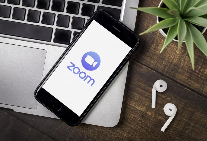 Smart phone showing Zoom Cloud Meetings app logo.
