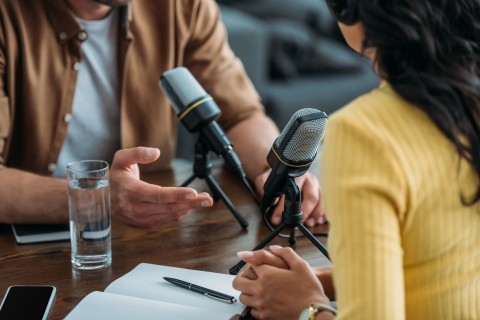 cropped view of two radio hosts recording podcast in broadcasting studio - Starting Something New is Hard